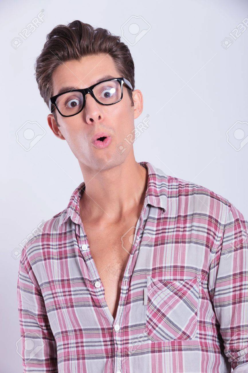 closeup portrait of a casual young man looking with surprise at the camera. on gray background Stock Photo - 20305838