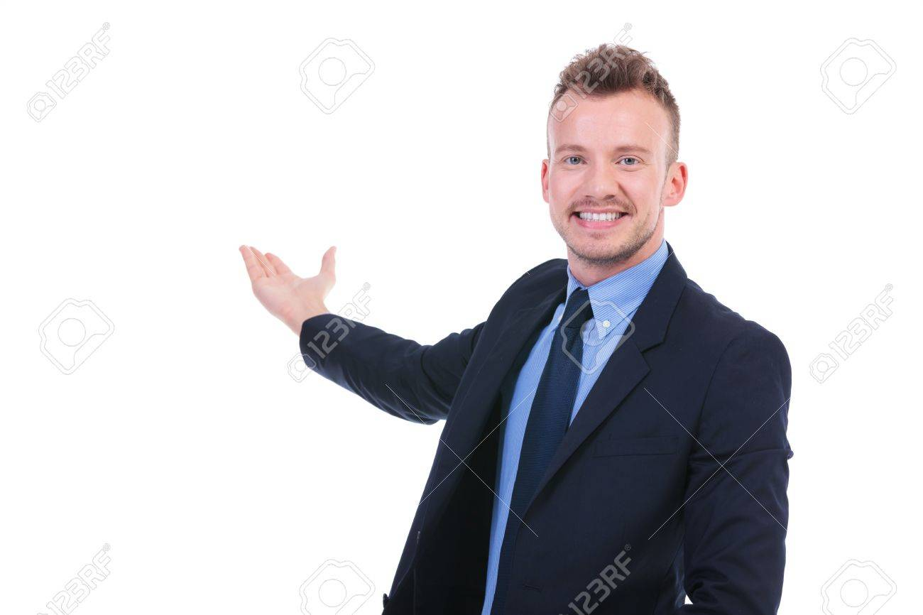 young business man presenting something in the back while smiling for the camera. on white background Stock Photo - 20665981