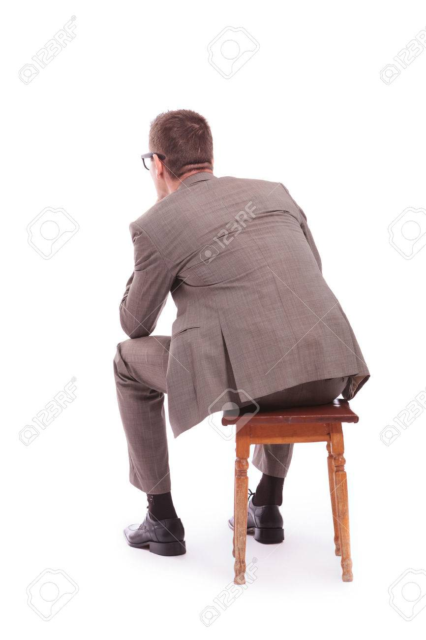 back view of a young business man sitting on a chair. on a white background Stock Photo - 23202583