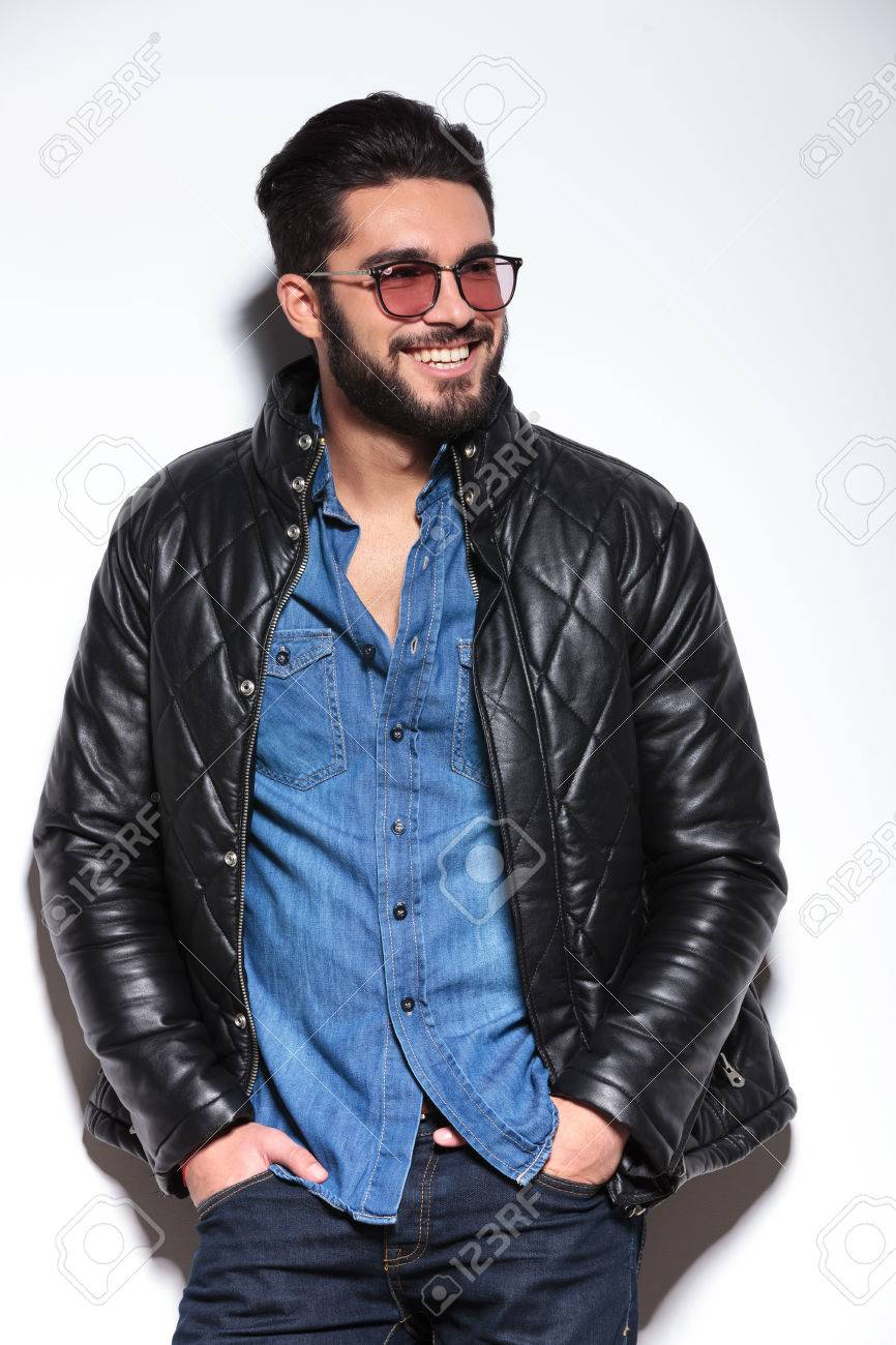 happy smiling casual man in leather jacket looking away to his side - 25242590