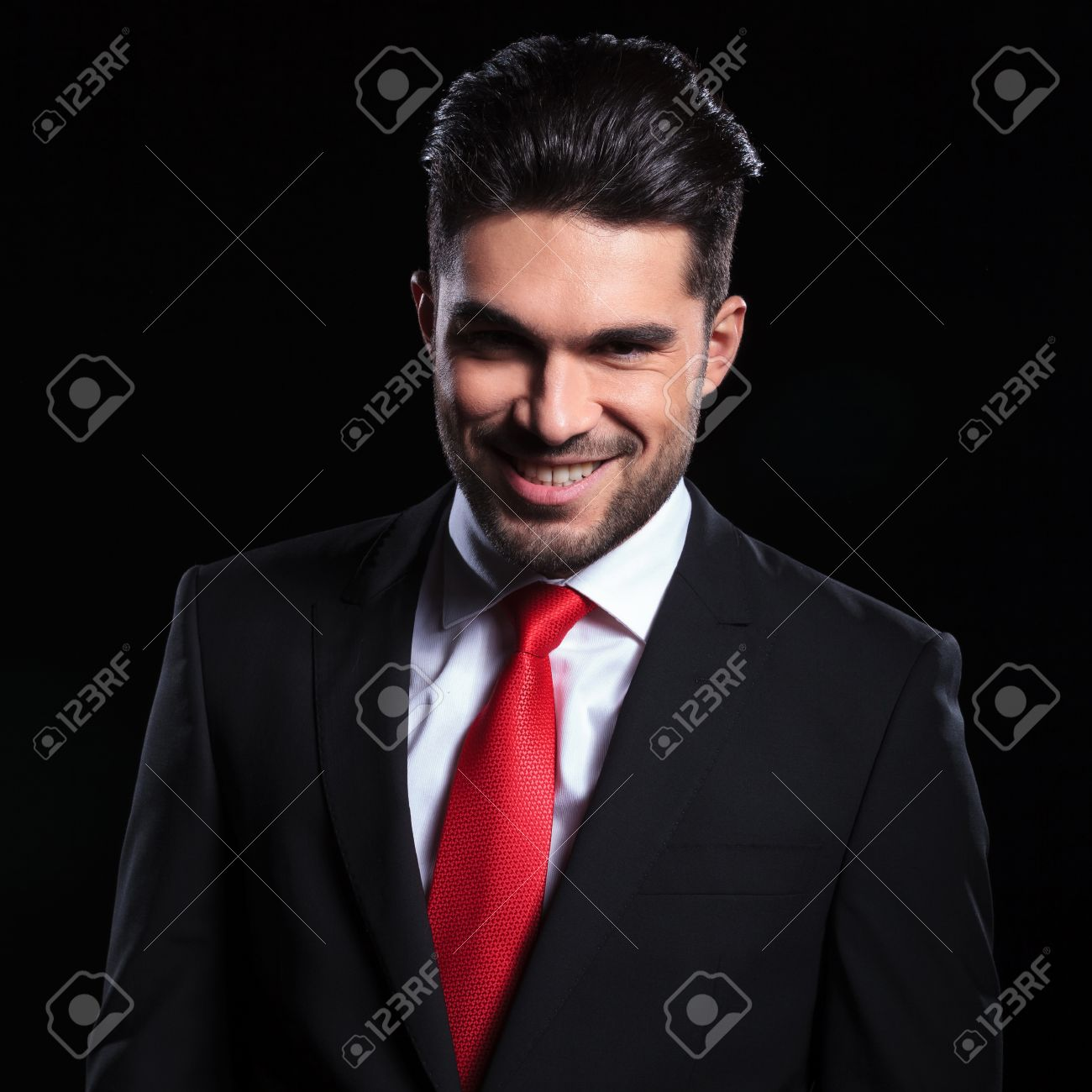 Young Business Man Looking Into The Camera With An Evil Smile Stock Photo Picture And Royalty Free Image Image 27104932 #whump aesthetic #evil smile #that scene where they're like 'the game is up' #and the other character smiles. young business man looking into the camera with an evil smile