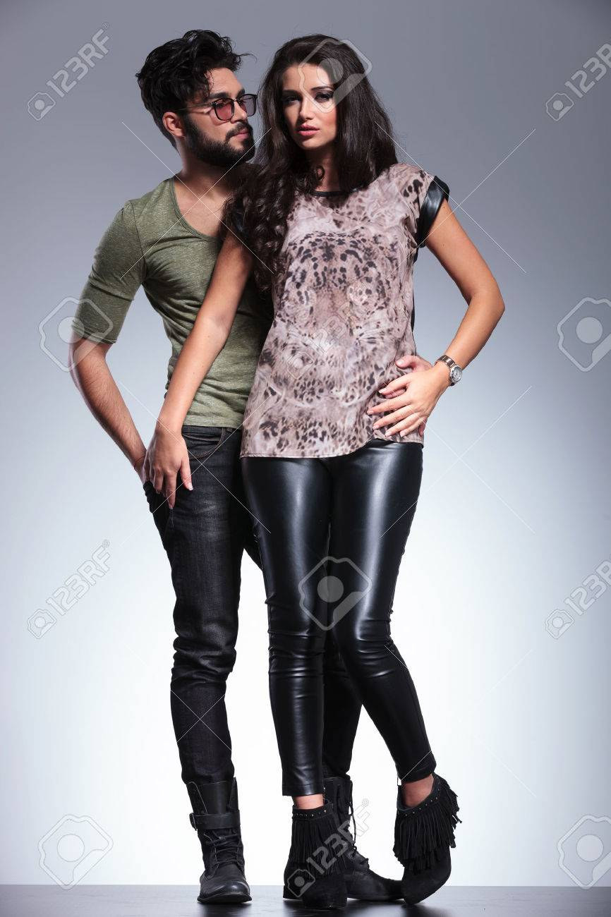 young man looking at his girlfriend and holding her close, full body studio picture Stock Photo - 27105013