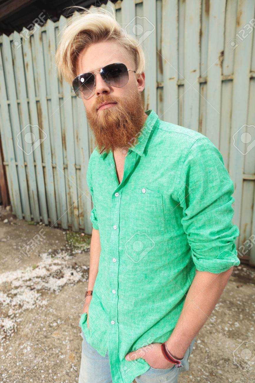 Casual Man With Beard And Nice Hairstyle Looking At The Camera Stock