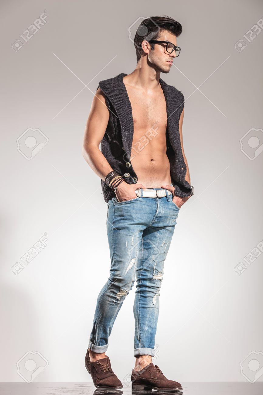 Side View Of A Fashion Man With No Shirt Wearing A Vest Looking