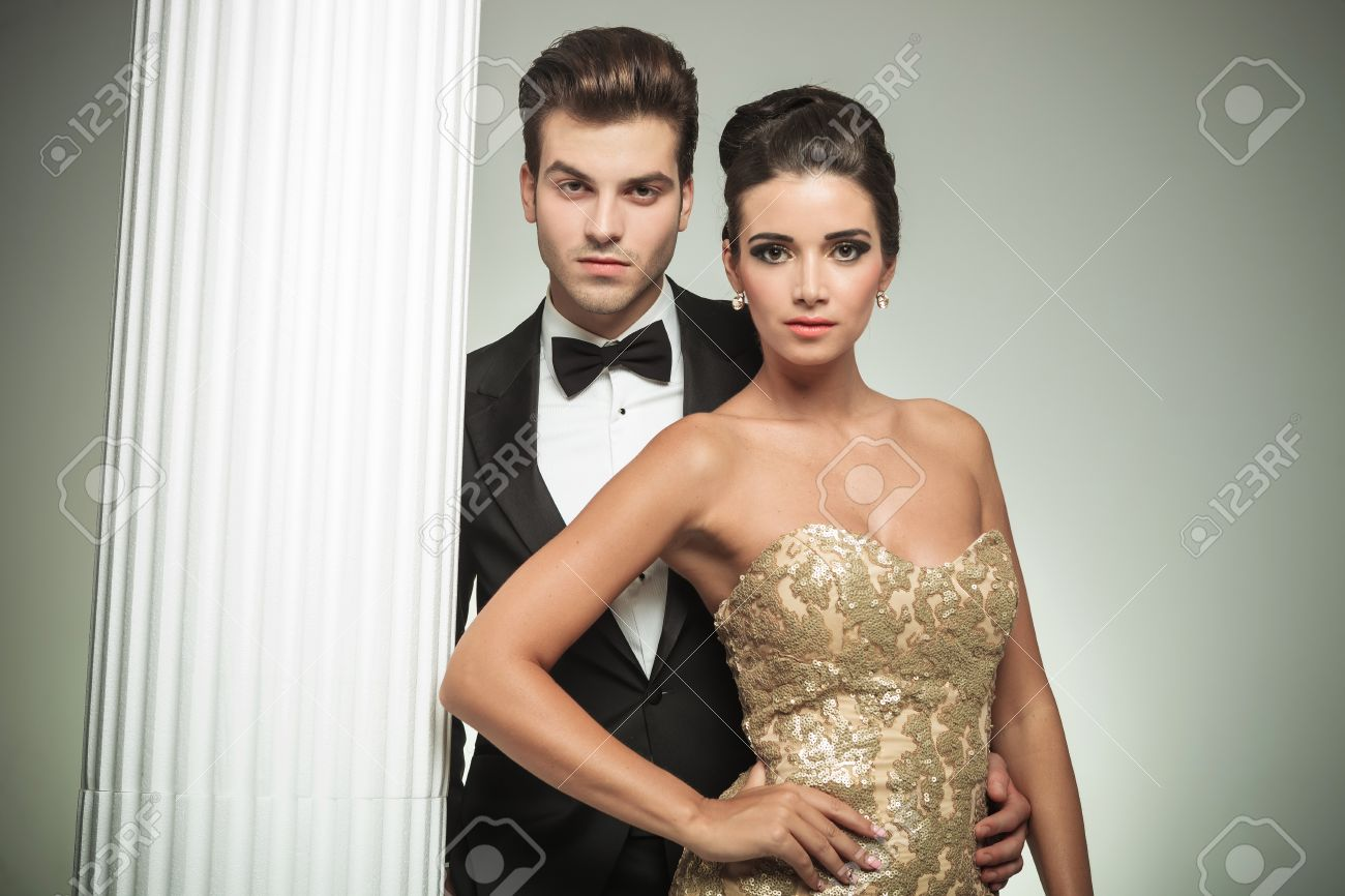 Fashion Elegant Couple Man In Tuxedo And Woman In Evening Gown ...