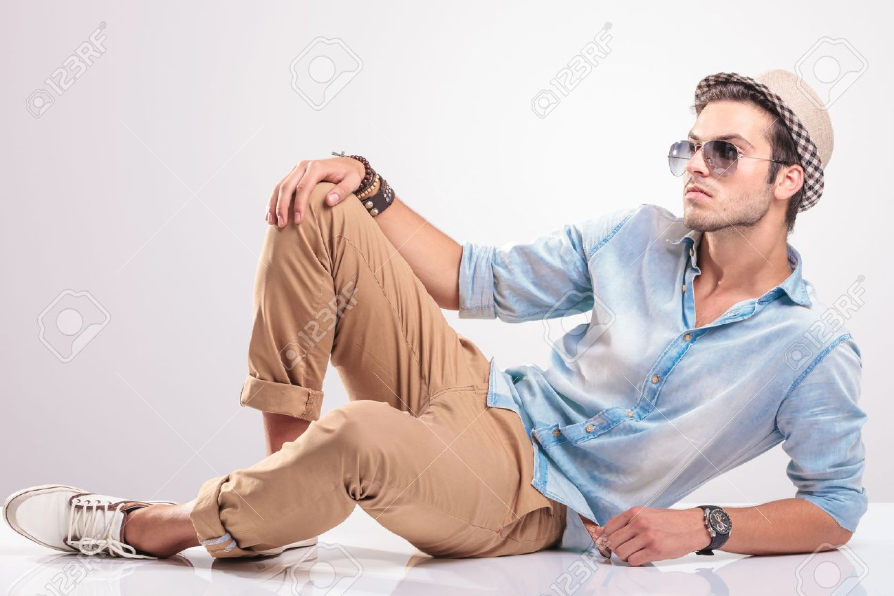 Man Sitting On Ground Profile