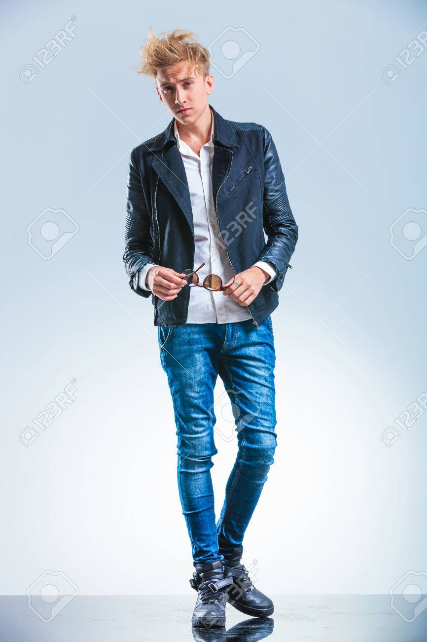 Sexy Blonde Boy Wearing Jeans And Leather Jacket While Holding