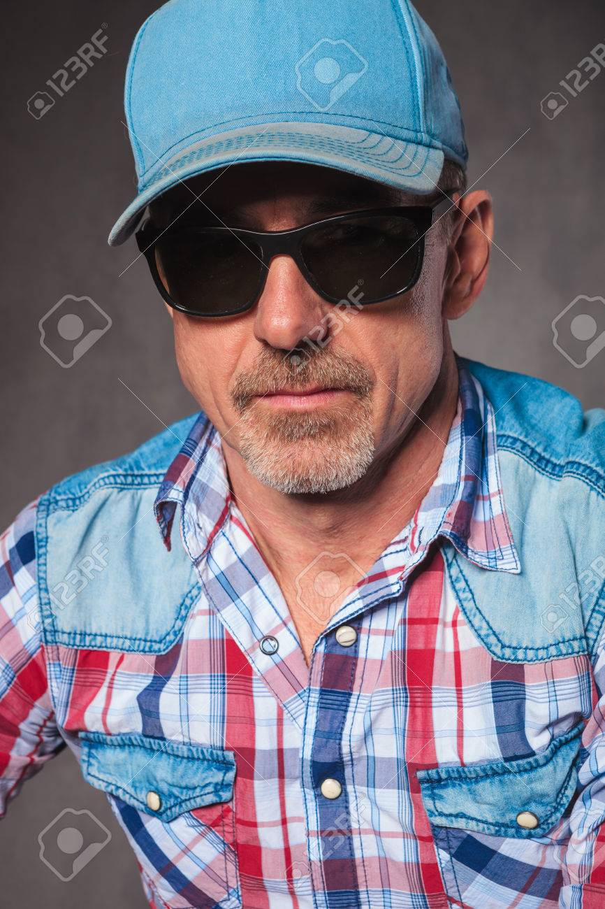 91f1b3348fc head and shoulders picture of a senior casual man wearing baseball hat and  sunglasses