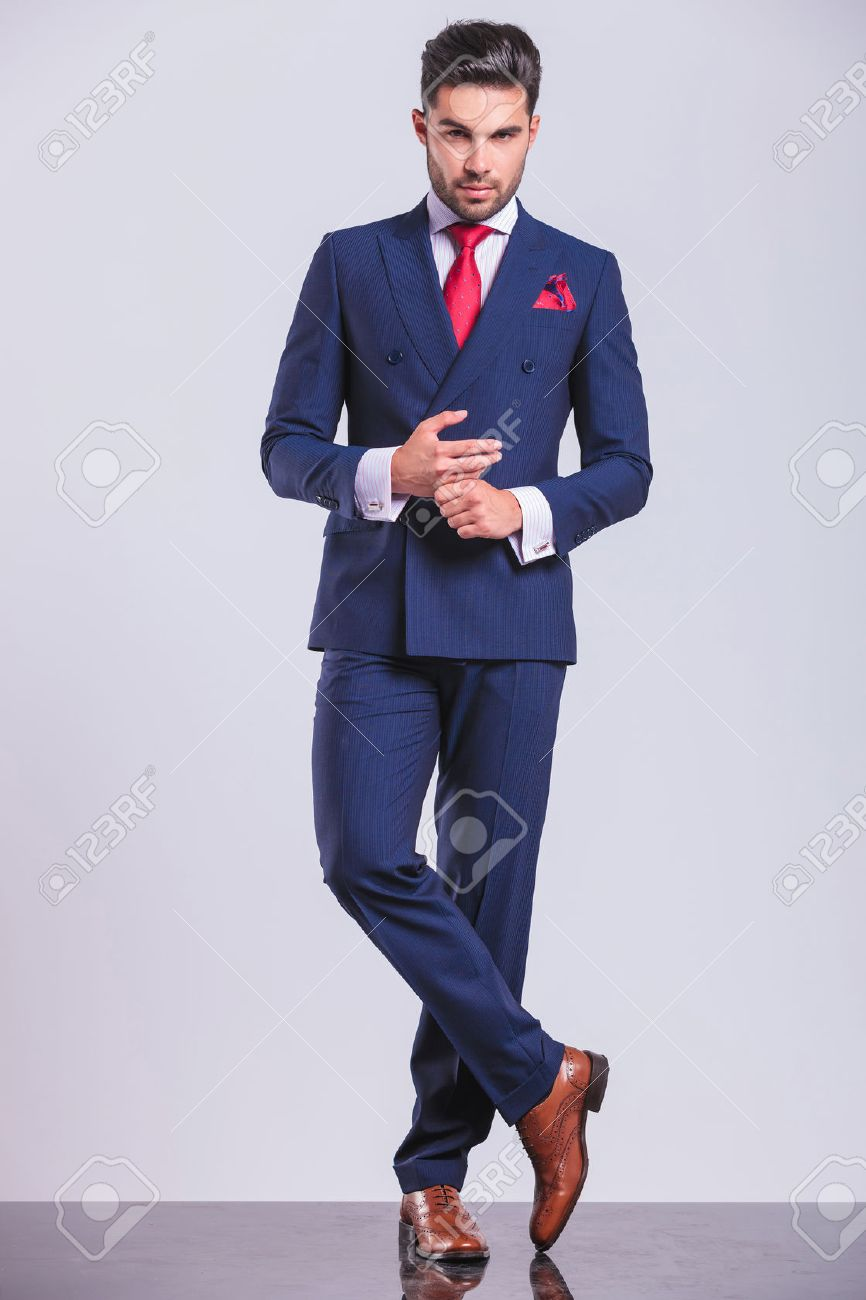 Full Body Picture Of Hansome Man In Suit With Legs Crossed While ...