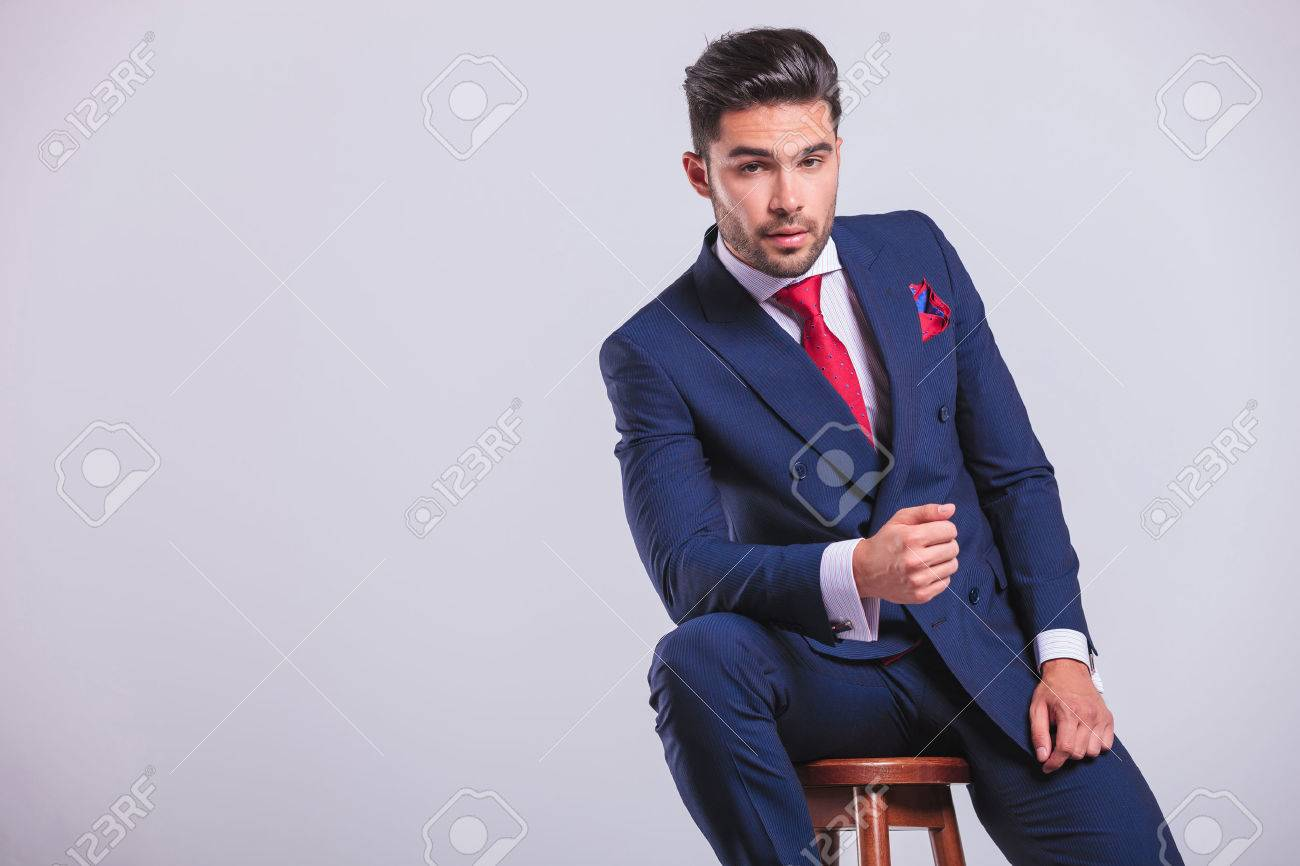 elegant corporate man leaning on a chair while sitting in studio Stock Photo - 48481048  sc 1 st  123RF.com & Elegant Corporate Man Leaning On A Chair While Sitting In Studio ...
