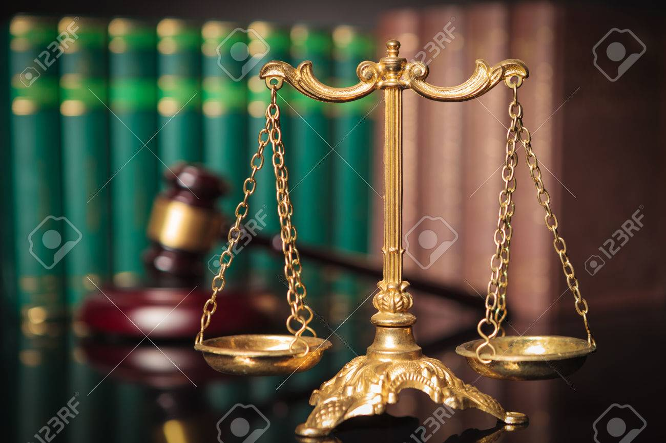 golden scale in front of judge's gavel and law books, justice concept - 51844693