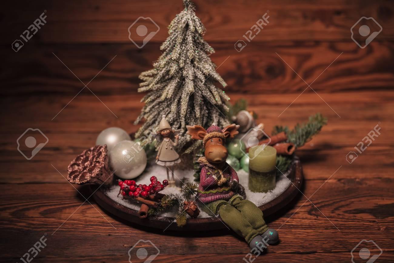 A Christmas Arrangement.Reindeer And Little Elf Girl On A Christmas Arrangement On Old