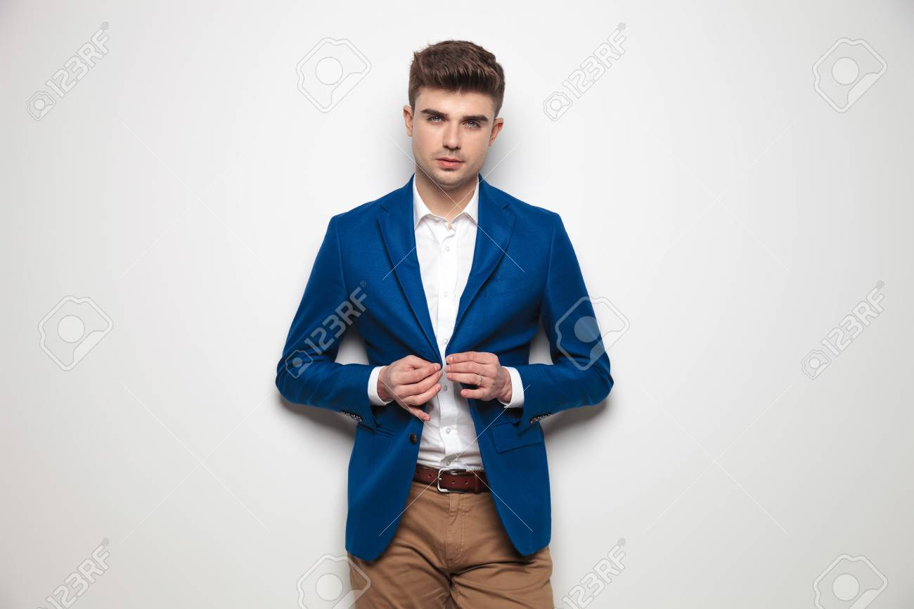 Sexy Smart Casual Man Buttoning His