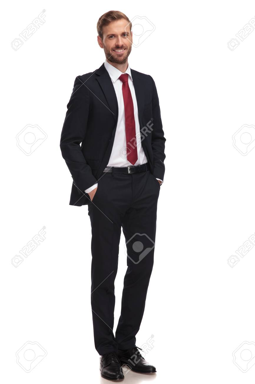 relaxed businessman smiling and standing with hands in pockets on white background - 109489409