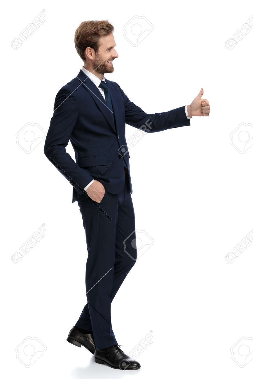 side view of happy businessman smiling and making thumbs up sign, walking isolated on white background, full body - 139566747