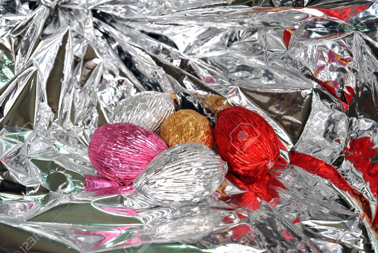 Wrapped easter eggs inside a glossy silver gift wrap stock photo wrapped easter eggs inside a glossy silver gift wrap stock photo 4675777 negle Images