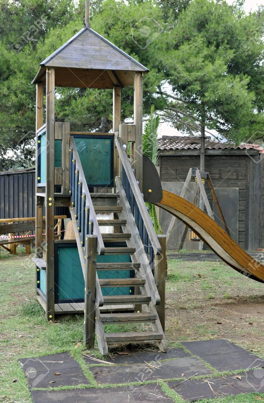 Playground wooden equipment with sliding Stock Photo - 5280234