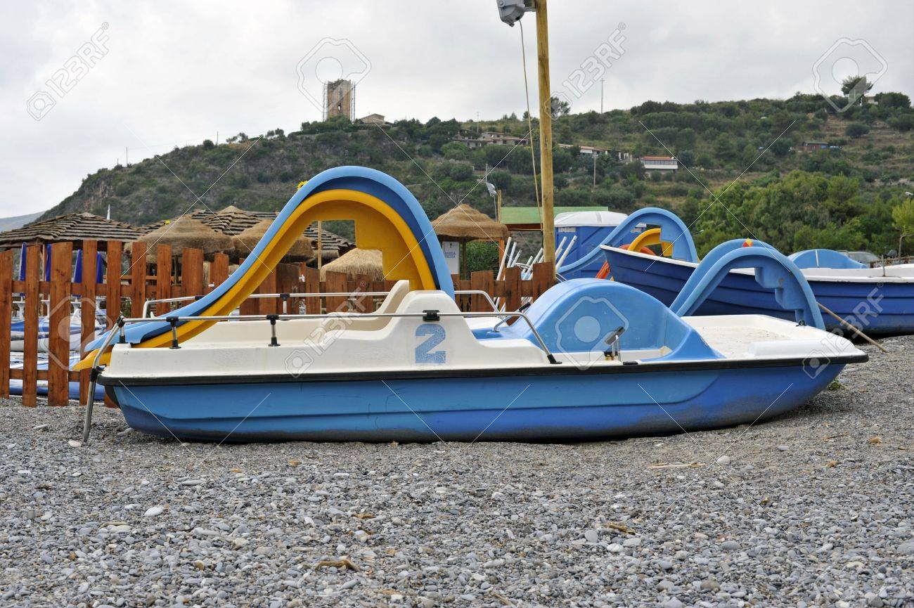 Seaside resort with pedalos on the beach Stock Photo - 5424322