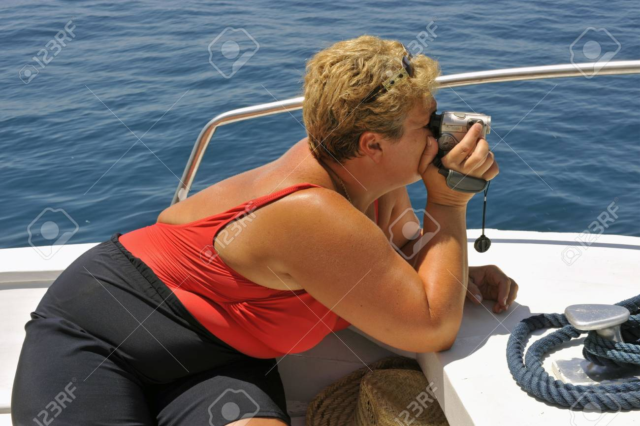 Tourist on a motorboat filming during a summer ride Stock Photo - 5652216