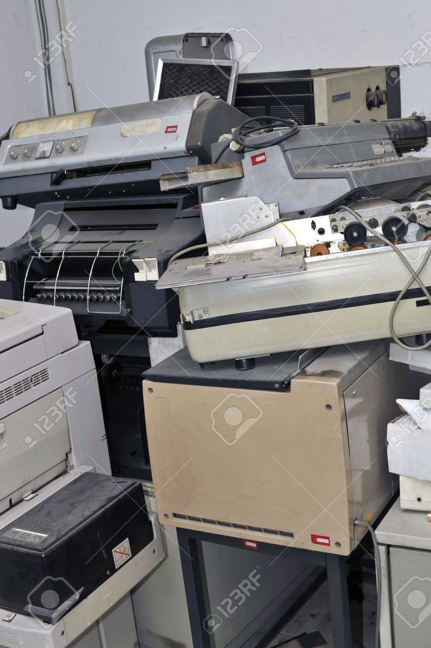 Old abandoned office appliances and equipments piled up in a storeroom Stock Photo - 5646119