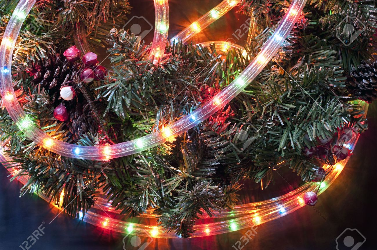 detail of a christmas garland with colored twinkling tube lights stock photo 6063742 - Tube Christmas Lights