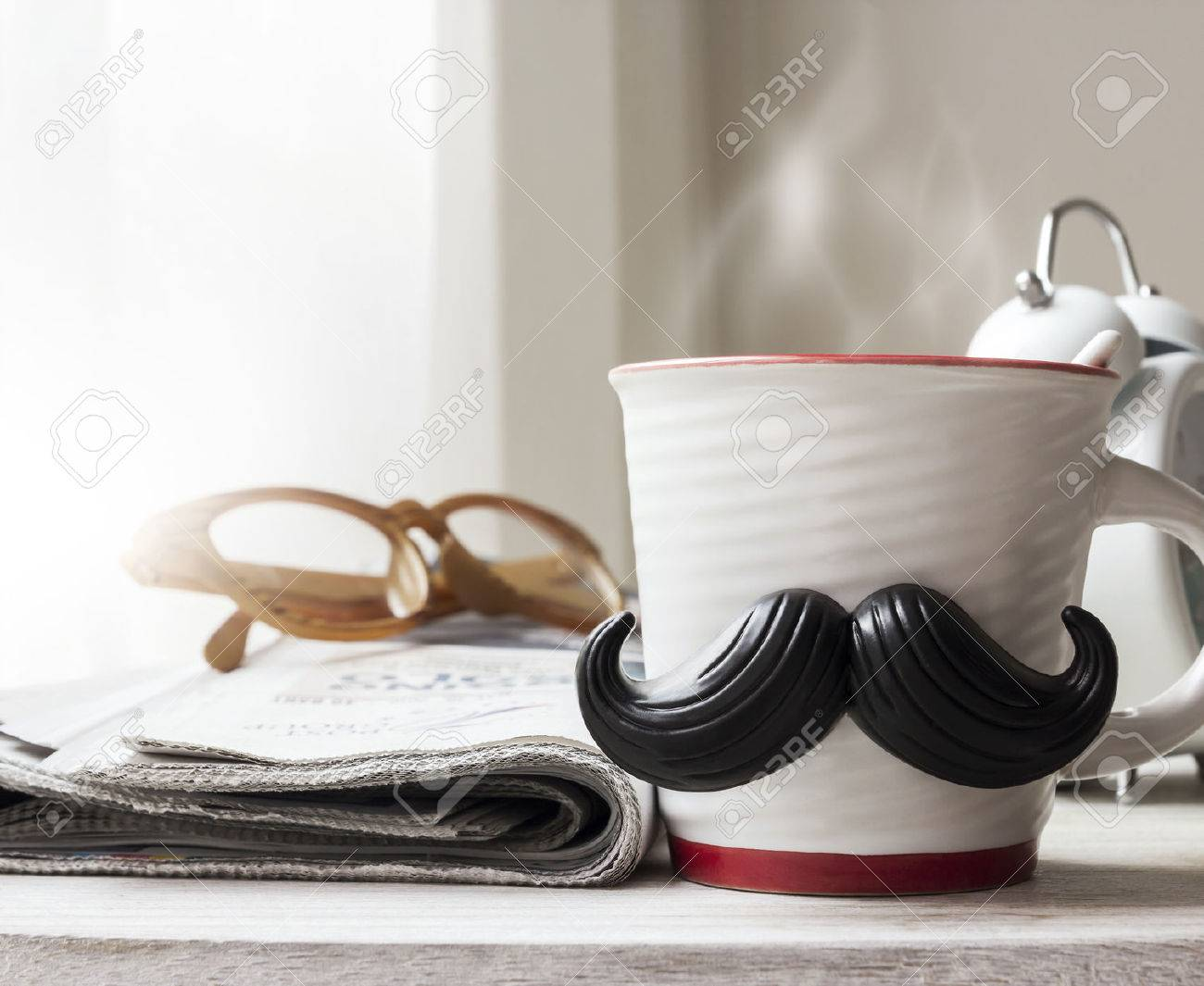 Cup with mustache on wooden table for fathers day concept - 56963101
