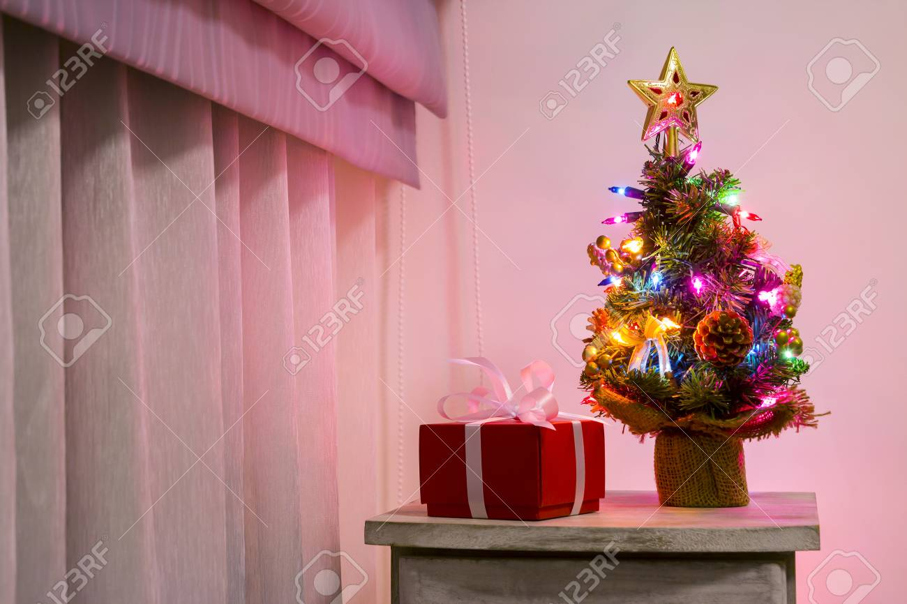 Colorful Small Christmas Tree On Cabinet In The Bedroom Stock Photo Picture And Royalty Free Image Image 67284983