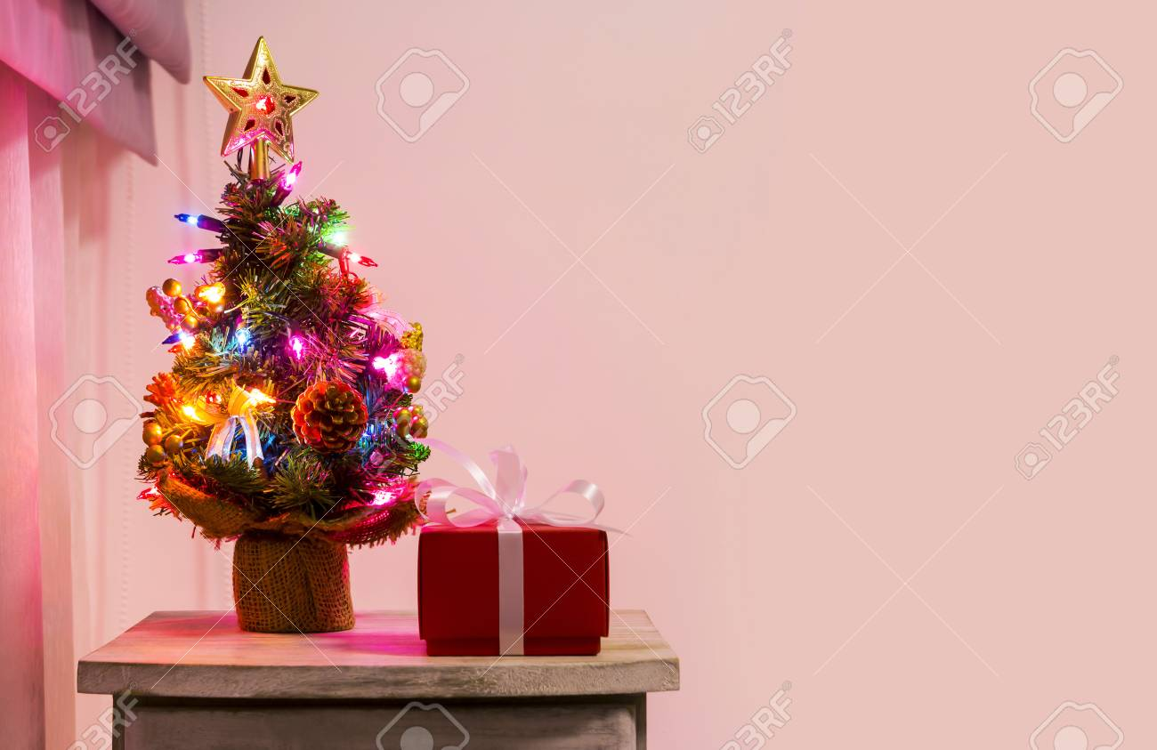 Colorful Small Christmas Tree On Cabinet In The Bedroom Stock Photo Picture And Royalty Free Image Image 67428293