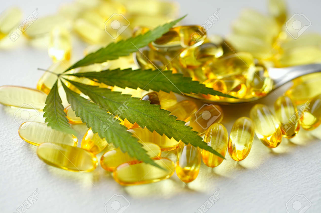 Cannabis Hemp Oil or CBD Oil Capsules, Food Organic Food Supplements. Alternative medicine concept. Cosmetics and skin care products - 169732024