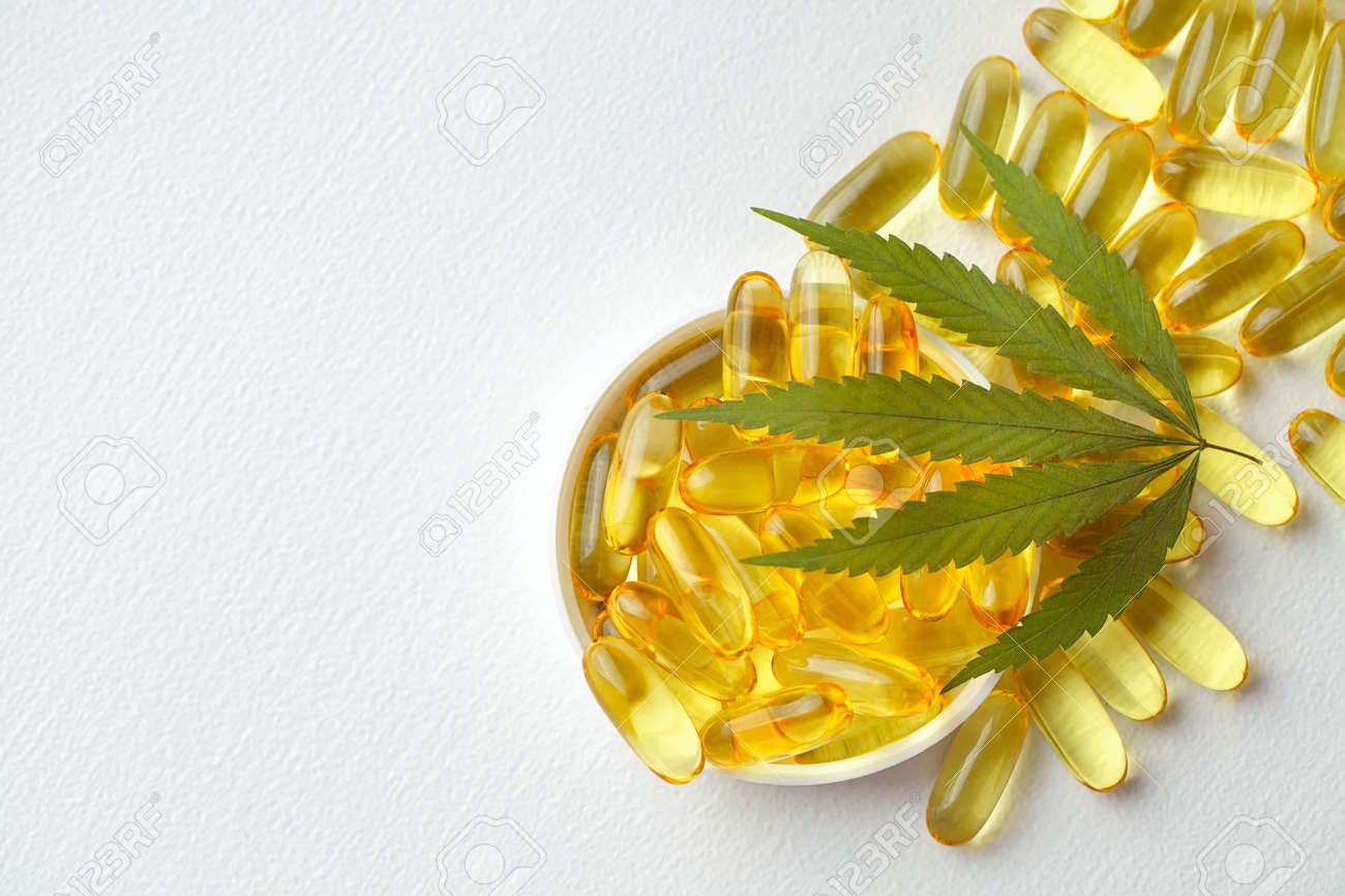 Medical cannabis products, leaf, capsules and CBD oil on white background. Pharmaceutical gelatin softgels with biological plant herbal. Organic dietary supplements concept - 169732308