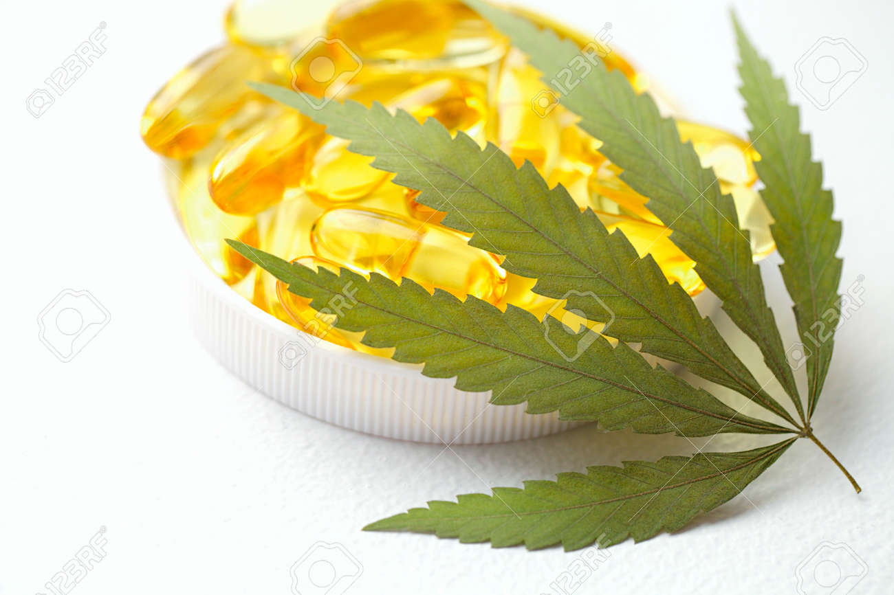 Medical cannabis products, leaf, capsules and CBD oil on white background. Pharmaceutical gelatin softgels with biological plant herbal. Organic dietary supplements concept - 169732311