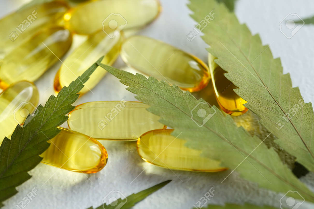 Cannabis Hemp Oil or CBD Oil Capsules, Food Organic Food Supplements. Alternative medicine concept. Cosmetics and skin care products - 169732248