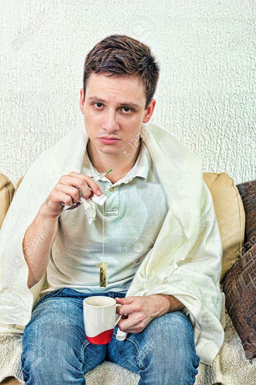 Young adult man treats himself with remedies  Get cold and looking