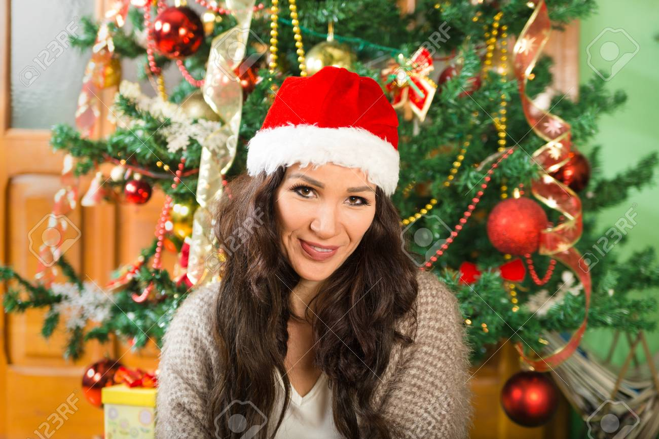 The Christmas Clause.Christmas Woman In Santa Clause Hat Happy Girl Celebrating
