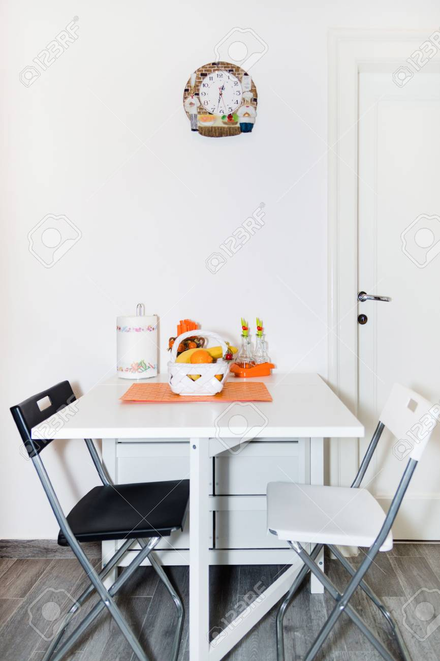 Interior of Small White Kitchen with Fresh Fruit Basket on the..