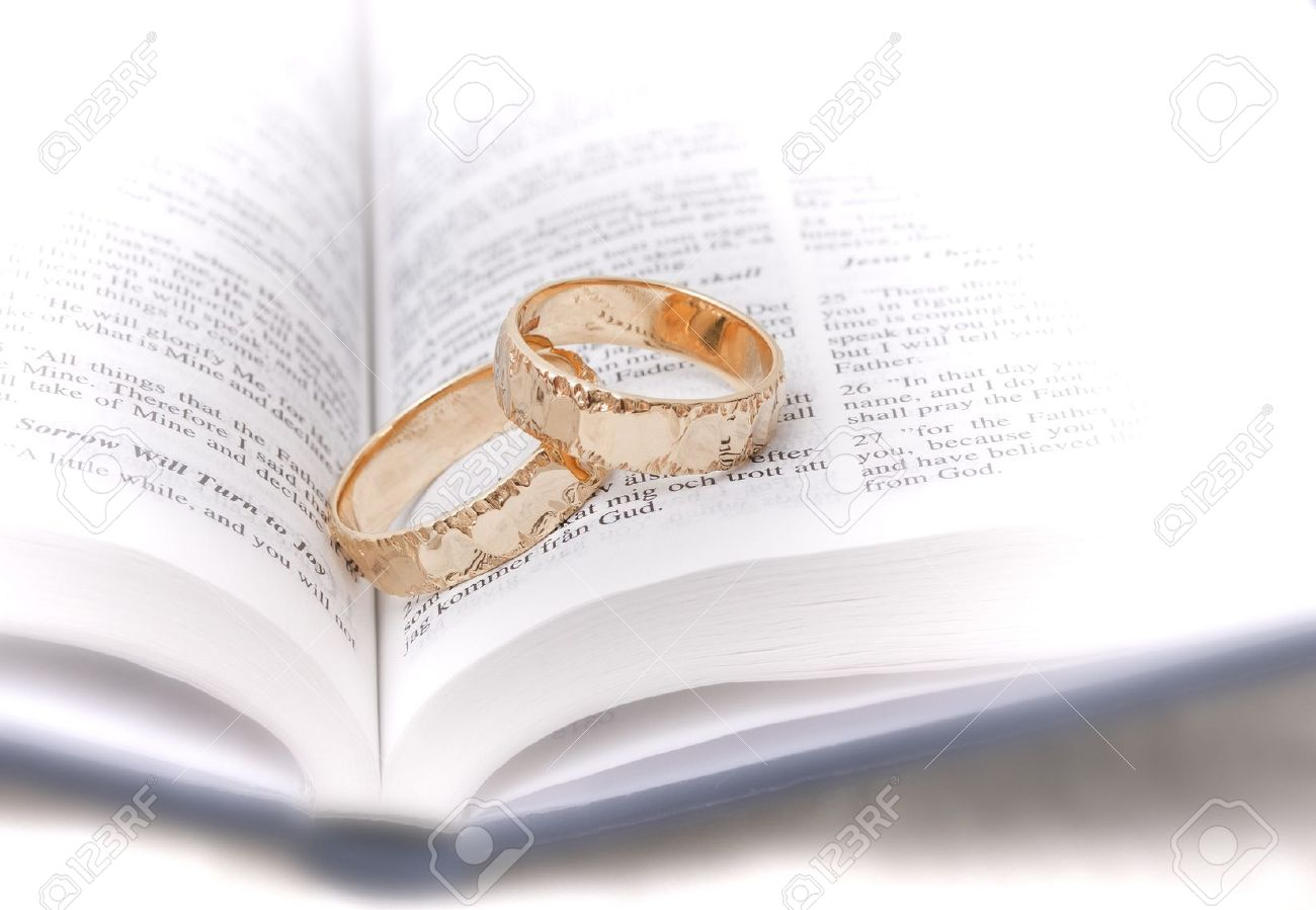 Gold Wedding Rings On A Bible Stock Photo Picture And Royalty Free