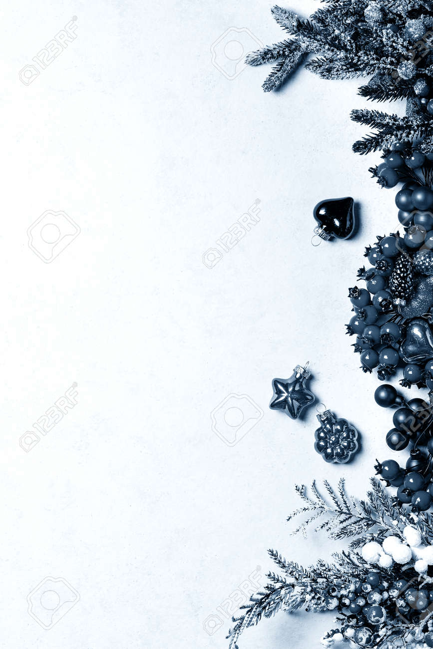 Traditional Christmas decorations over white texture background. Top view, flat lay. Copy space. Color of the year 2020 classic blue toned - 142697845