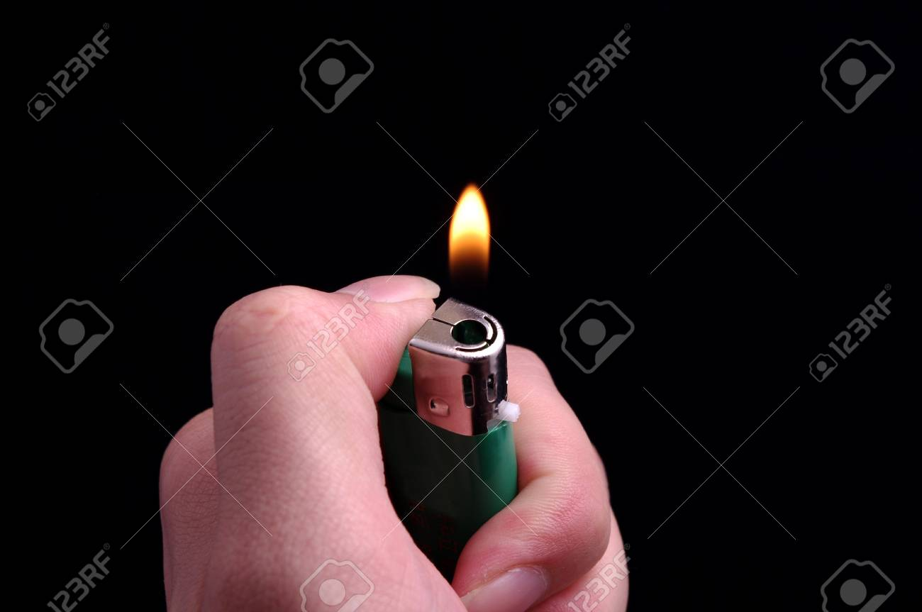 Hand and a lighter Stock Photo - 14516536