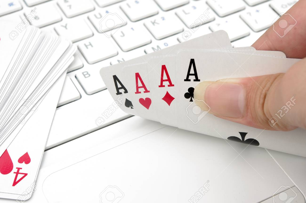 Poker and the computer keyboard  the expression of an online poker game or against the concept of online gambling Stock Photo - 14516577