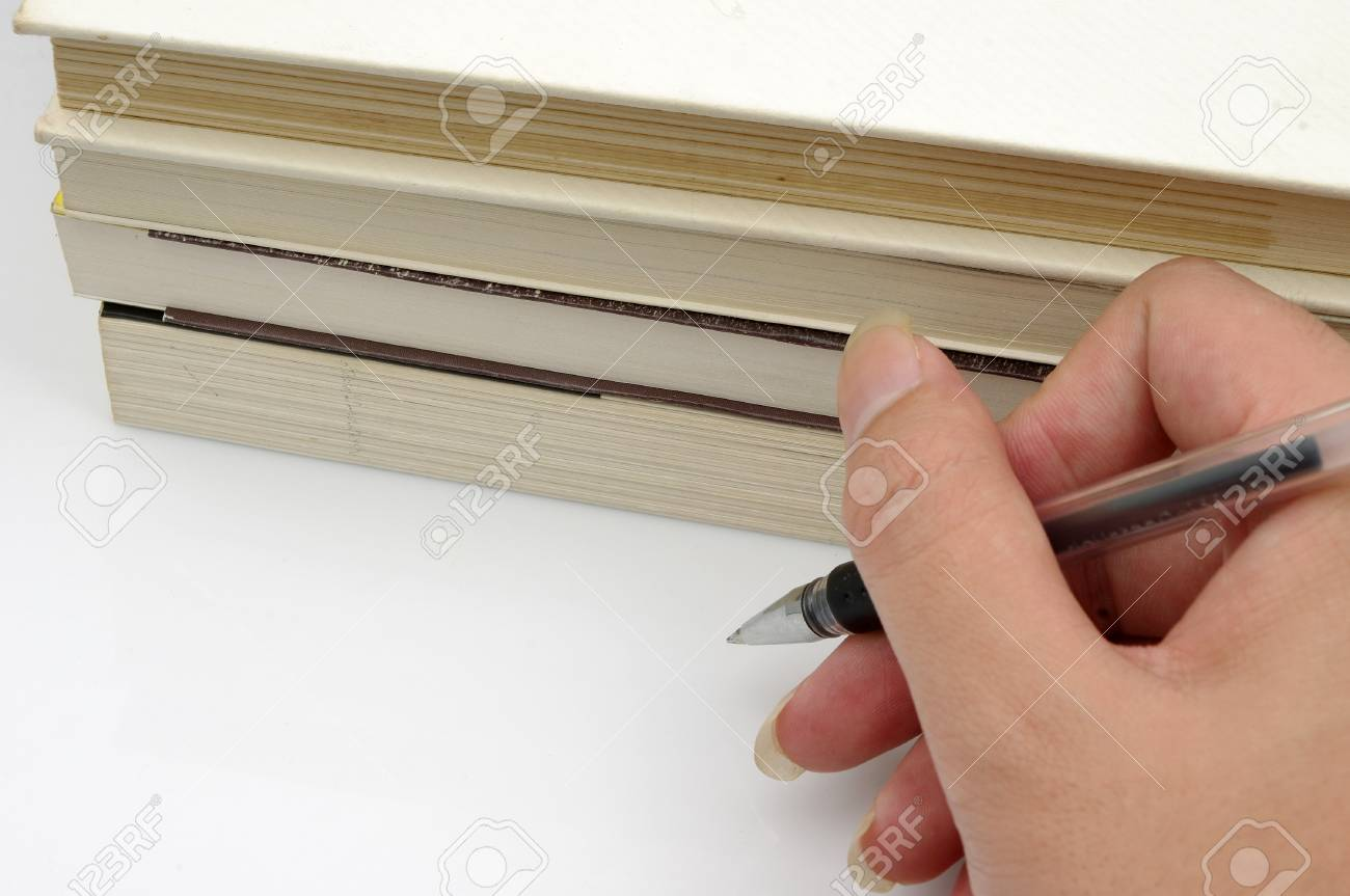 Pens and books  to express the concept of reading Stock Photo - 15126647