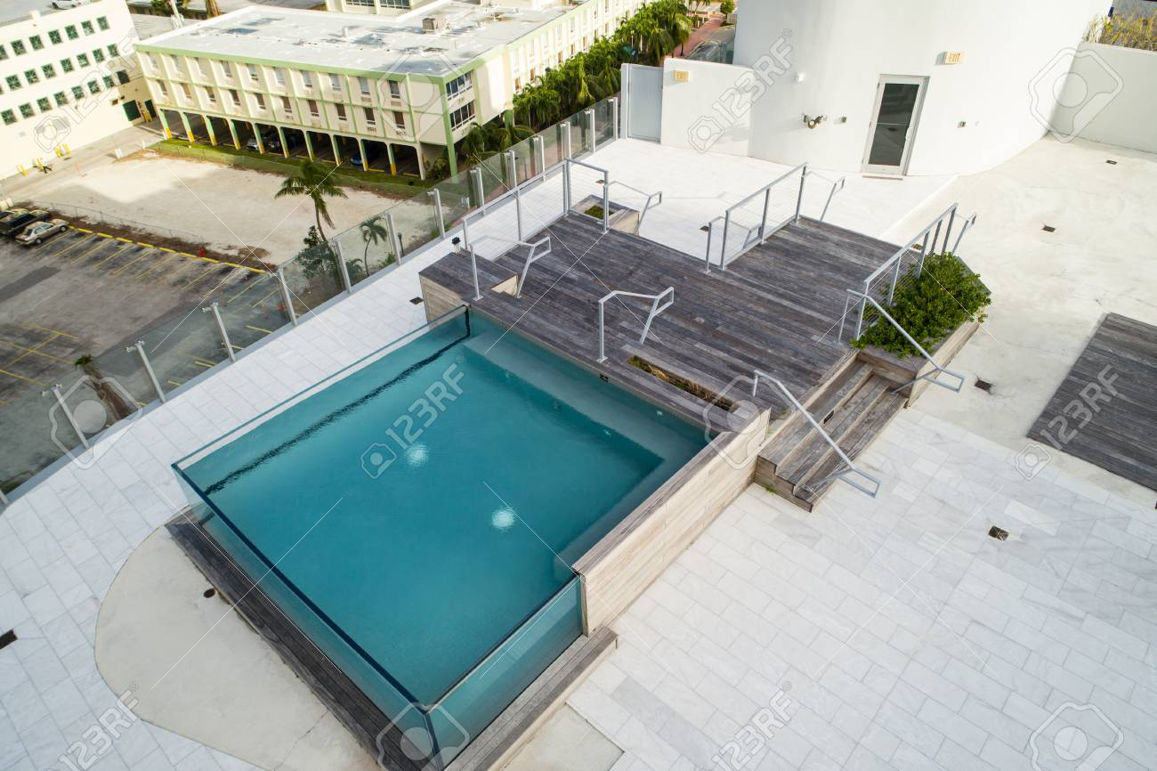 Aerial image of a contemporary rooftop swimming pool made from..