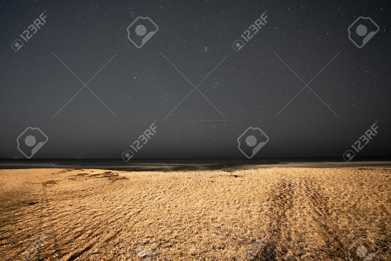 Night stars over the beach sand - 161260345