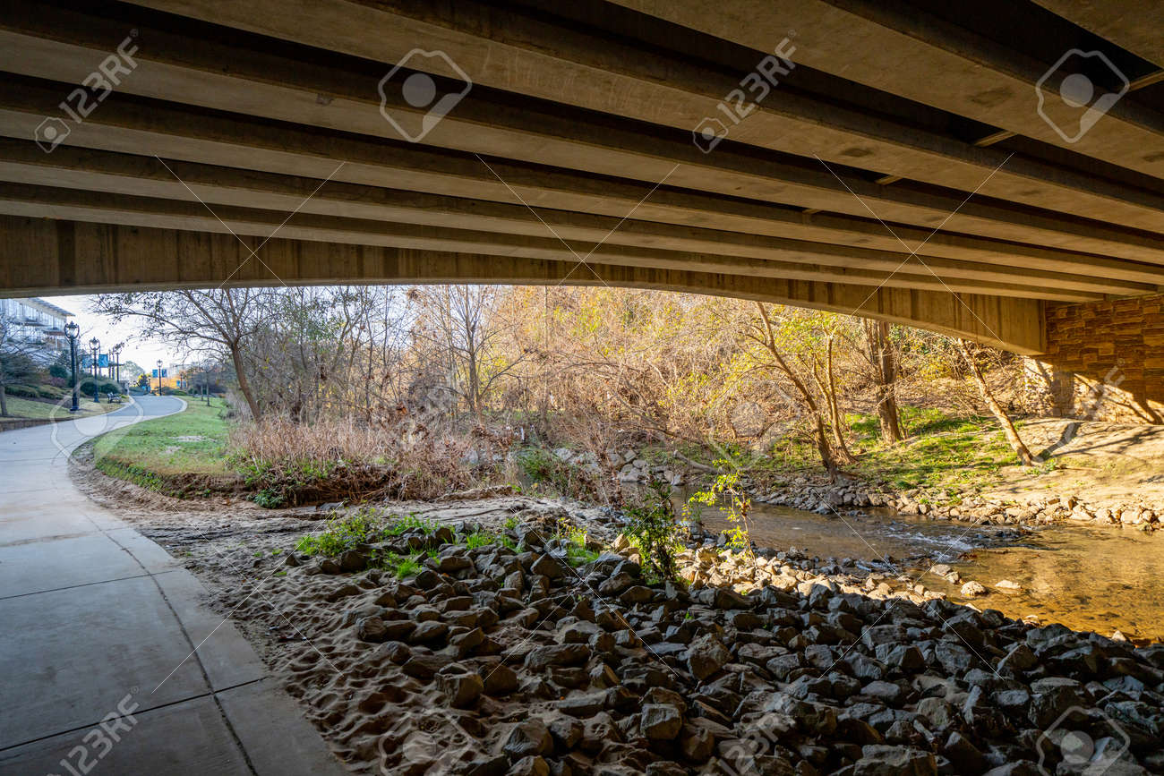 Under a bridge by the Little Sugar Creek NC USA - 161257974
