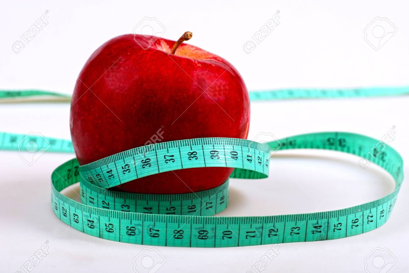 measurement and red apple close-up on white background Stock Photo - 10409379