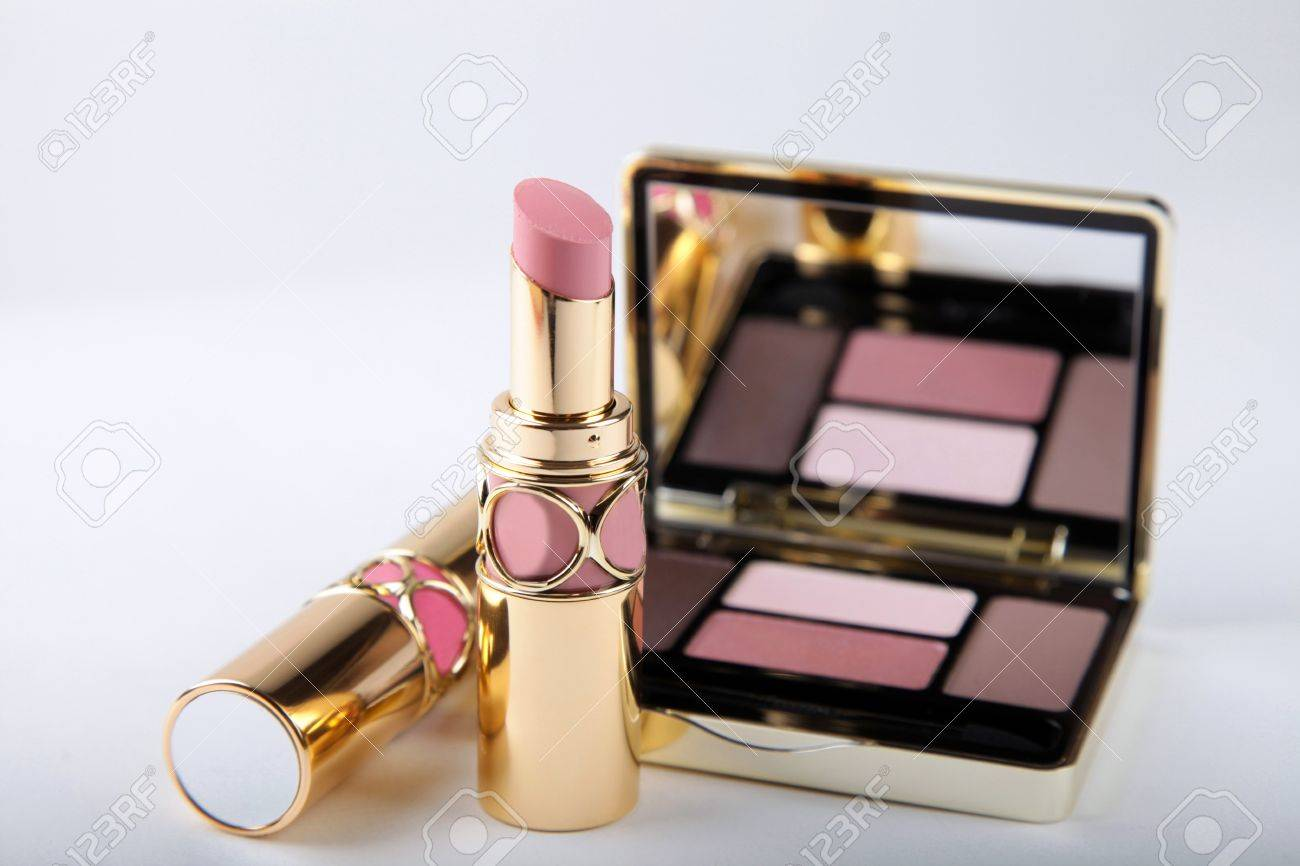 studio shot of luxury eyeshadow palette with mirror and lipsticks in pink and beige colors Stock Photo - 13802792