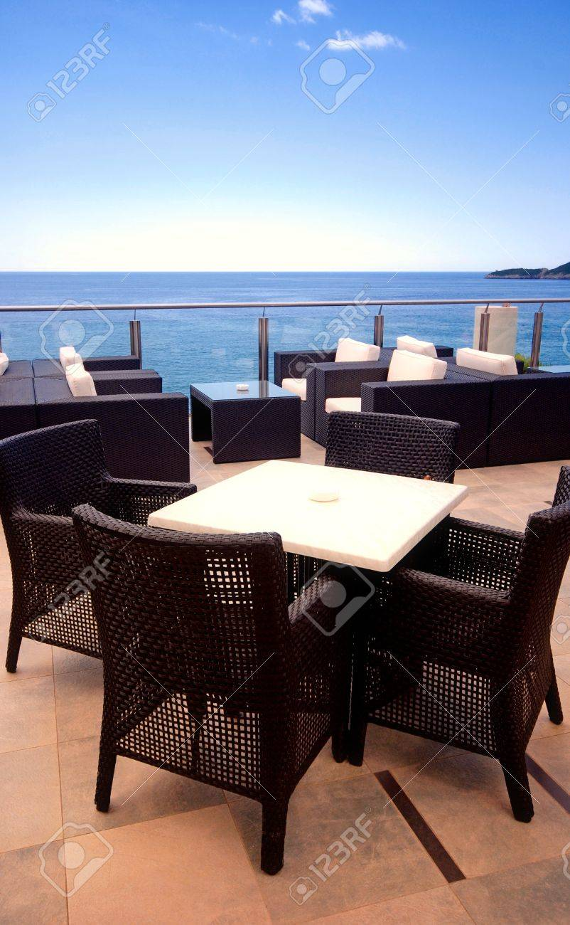 Rattan armchairs on the terrace lounge with seaview in a luxury resort . Stock Photo - 13848664