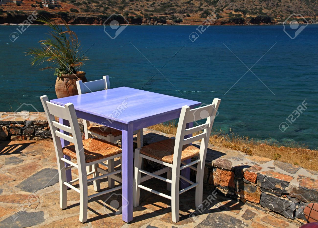 Superior Outdoor Restaurant   Traditional Greek Tavern With Lilac Table And White  Chairs Overlooking Mediterranean Sea (