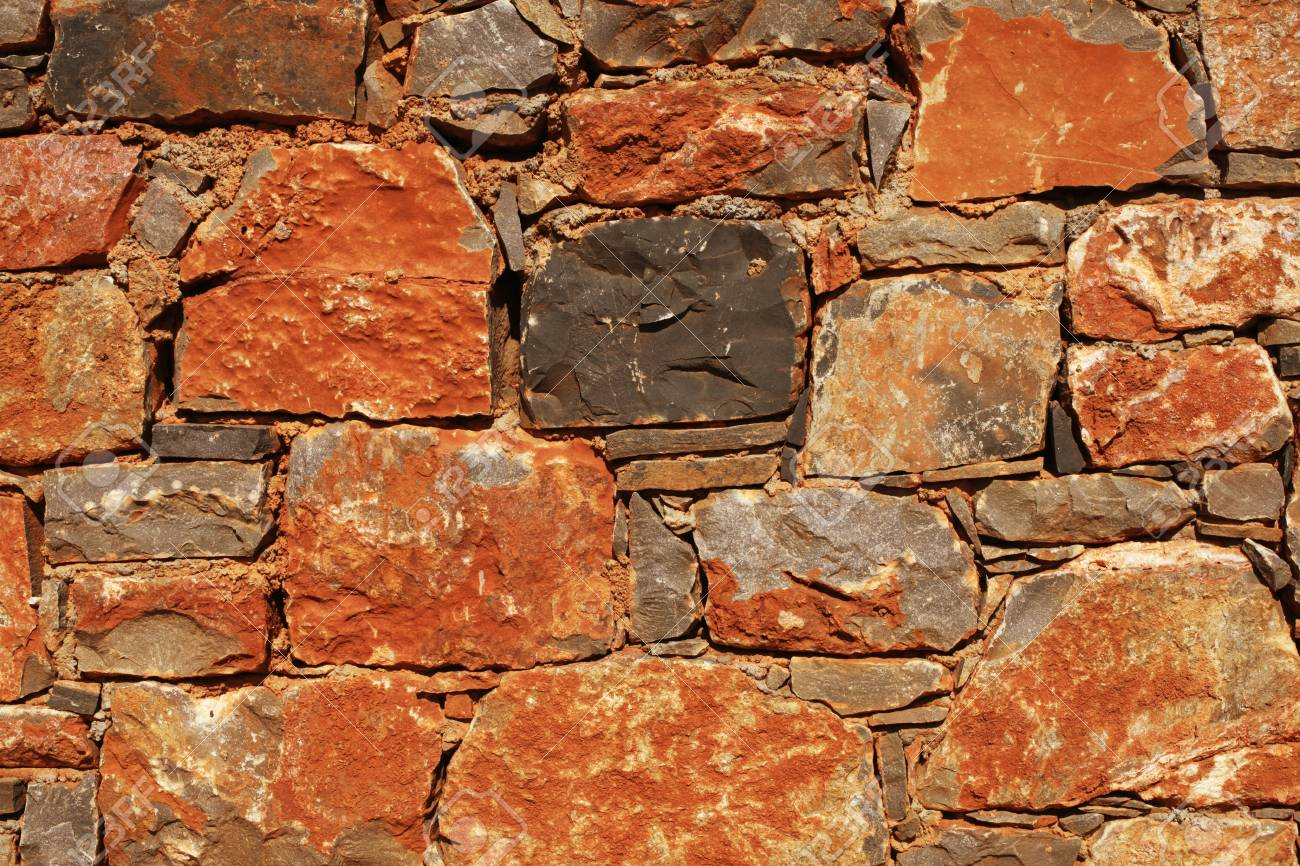 rough mediterranean red and gray stone wall as background Stock Photo - 15823156
