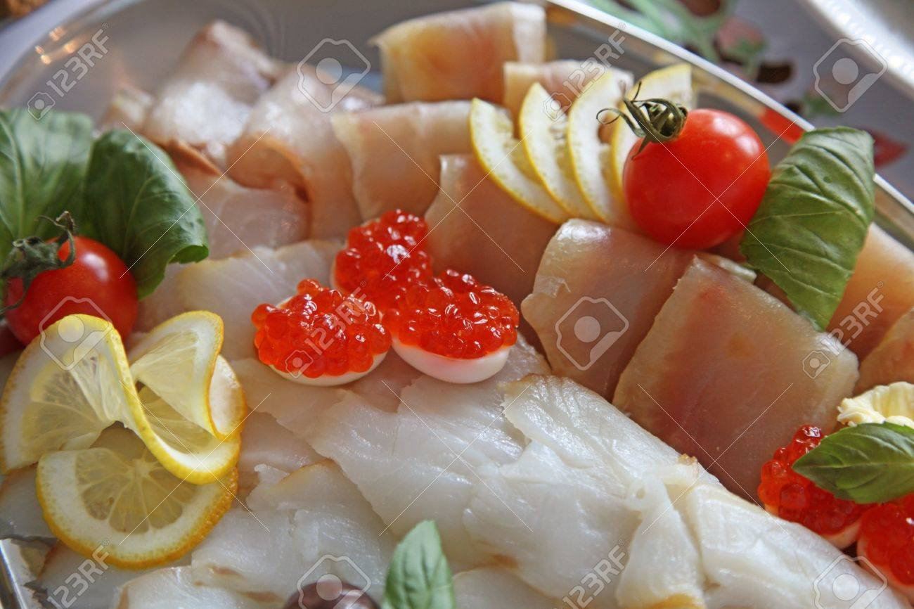 Dish of delicious appetizer with smoked fish and caviar. selective focus Stock Photo - 17000729
