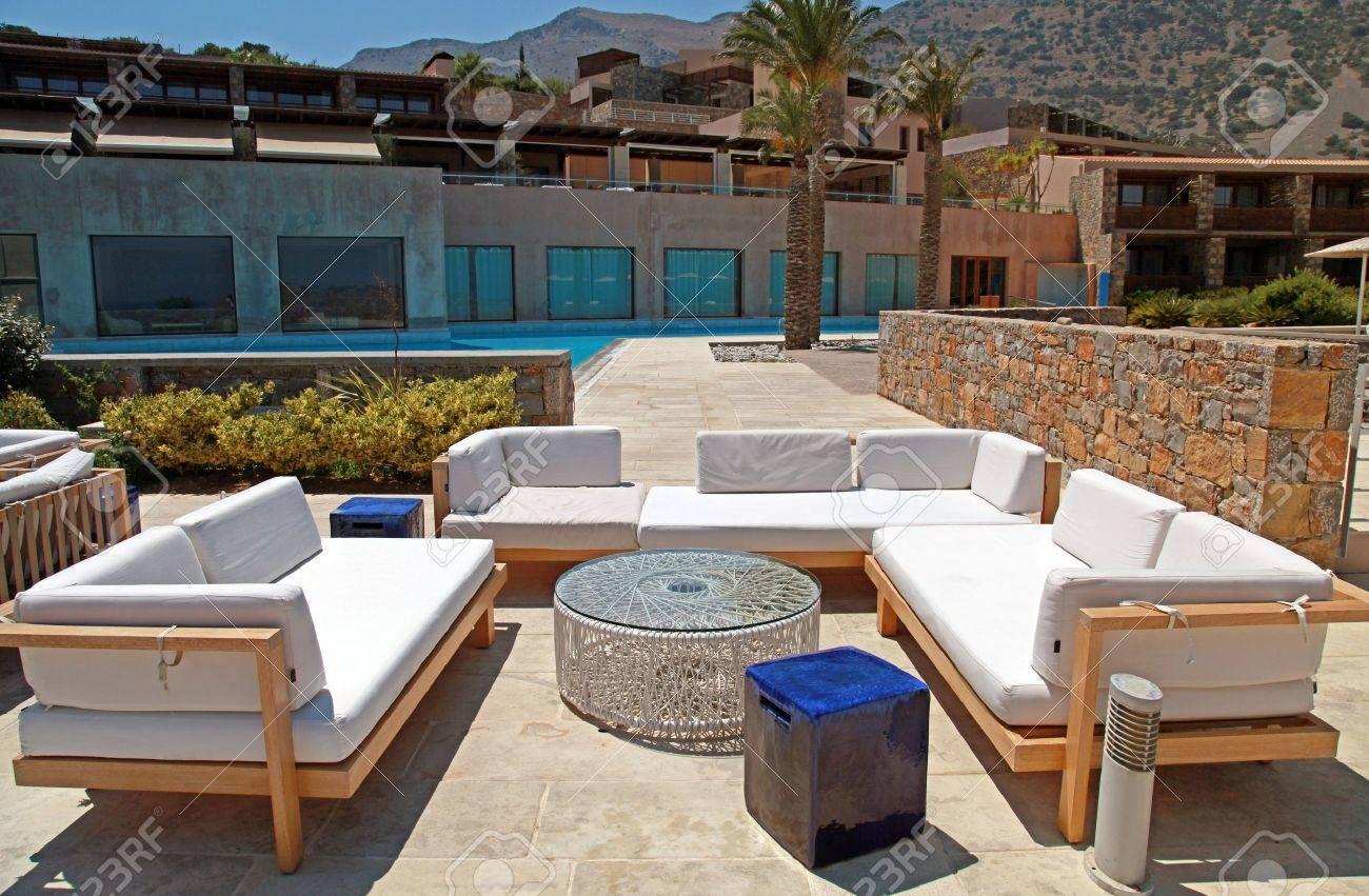 Outdoor furniture on beautiful mediterranean patio in summer resortgreece wide angle stock